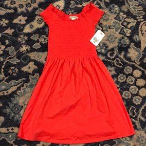 An off the shoulder summery dress.
